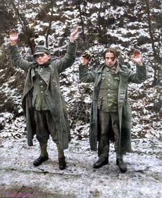 Two young German Wehrmacht soldiers surrender to Allied forces along a roadside during the Battle of the Bulge. If you look carefully, the soldier on the right is wearing US gaiters. The battle was Germany's planned offensive with the primary goal to recapture the important Belgian harbor city of Antwerp from the Allies. The Battle of the Bulge is one of the most important Batlle in the entire World War 2. Photo taken Near Snamont, Liège, Wallonia, Belgium. 1 January 1945.