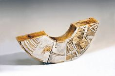 """Patricia Sannit: Cradle, 2010, 21""""x32""""x12"""", hand-built, carved and incised reclaimed clays, slip and stain"""