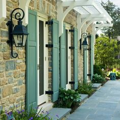 Awning over front or back door- love the trellis all the way down the house