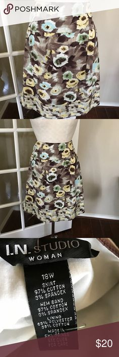 Floral print brown skirt Floral print brown skirt in excellent condition. i.n. studio Skirts
