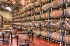 Adelbert's Brewery Taproom in Austin, TX - wall of beer aging in barrels Photo by: Kevin Gourley