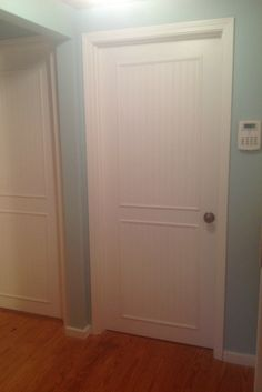 Add trim to a plain door for more interest.