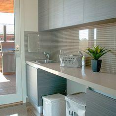 Clean & Fresh - fantastic laundry space by Pivot Homes. Love the tiled splash back! http://www.pivothomes.com.au/