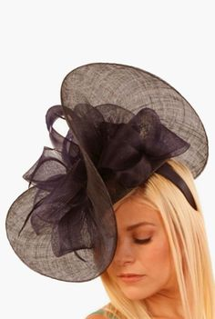 A stunning and chic hat that will have everyone thinking you just walked off the runway from Milan! This chic organza hat features a high display of bows on a sheer background. Wear the hat angled to