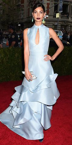 100+ Unforgettable Dresses From the 2015 Met Gala   LILY ALDRIDGE   in a powder-blue tiered and ruffled gown with a modified Mandarin collar, jade-colored earrings and a deep wine lip, plus a Judith Leiber koi-shaped clutch.