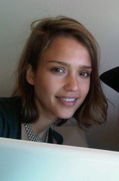 Jessica Albas brunette, mid-length hairstyle