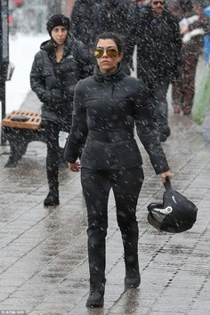 Snow problem: Kourtney looked ready to rock as she arrived at the ski slopes - she was joined on the getaway by her ex-partner and father of her three children Scott Disick