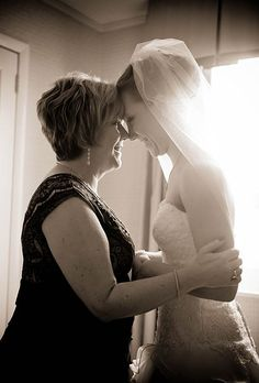 Heart warming photos of mom and bride. And look at those pearl earrings!
