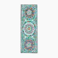 what it is: The Mint Yoga Mat from Magic Carpet Yoga is a yoga mat that not only looks beautiful, but provides the perfect surface to practice yoga, whether at home, or on-the-go. It's 1/4 inch thickn