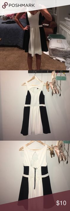 Macy's black and white dress A never used dress, black and white, 90% polyester 10% Spandex, nice length. Material Girl Dresses Midi