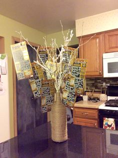 DIY wine bottle wrapped in twine used as a vase for lottery ticket gift arrangement. #PinterestInspired #DIY