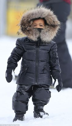 All the gear:In addition to her jacket, Nori was also dressed in a knitted roll neck sweater, big padded black pants and a pair of Hestra mittens and baby matching black Sorel boots