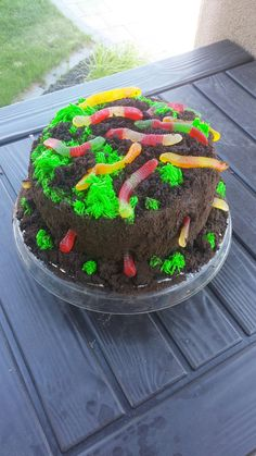 Worms and Dirt cake. Chocolate fudge cake, chocolate buttercream, green vanilla buttercream with a grass tip, cookie crumbs, chunks of cake and gummy worms. Chocolate Fudge Cake, Chocolate Buttercream, Vanilla Buttercream, Bug Birthday Cakes, Birthday Ideas, Halloween Birthday, 7th Birthday, Worm Cake, Grass Cake