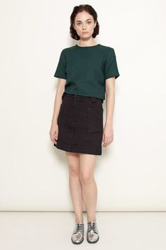 This boxy forest-green top by Wray features a warm, textured fabric and a slightly cropped cut. Pair it with the brand's Cubist skirt for an appealing, modern look.