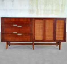 Unattributed Walnut, Cane and Aluminum Cabinet by American of Martinsville, 1950s. A little help here? AofM employed both in house and outside designers.