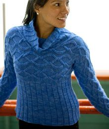 Wingspan by Julia Trice.  This pullover features cabled sleeves and upper body, with a ribbed lower body and cowl.