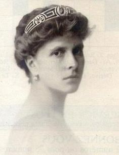 The Greek design is appropriate since this tiara belonged to Princess Andrew of Greece and Denmark (above, born Princess Alice of Battenberg), mother of Prince Phillip.