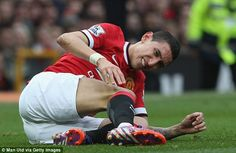 Di Maria lies in pain holding his knee during the first half at Old Trafford on Saturday afternoon