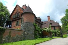 """The centerpiece of the estate is the 44-room country home. The enormous manor (Choate called the building a """"cottage"""") cost $35,000 to complete."""