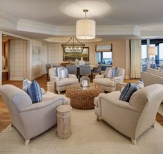 Round sitting area with four chairs and a round coffee table, Ralph Lauren woven…