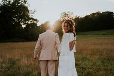 Groom in pink wedding suit, bride in backless ASOS wedding dress. Pastel colour oversized wedding bouquet. Gingersnaps Photography #festivalwedding #pinksuit #groomsinpink #asosweddingdress