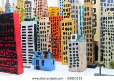 cardboard, paint - very colorful. maybe have a few like this in the toy city