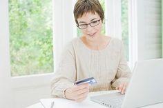 Paying off credit card balance via computer