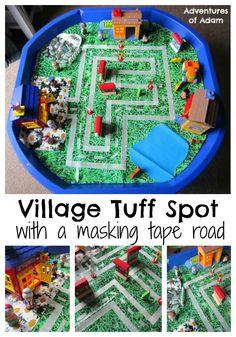 V is for Village Tuff Spot Small world Tuff Spot Builders Tray with a masking tape road   http://adventuresofadam.co.uk/village-tuff-spot/