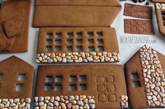 Royal icing piped onto gingerbread house in the random shapes of stones and hand painted with food coloring. Fabulous effect!