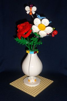 Eye-Opening Tricks: Modern Vases Home tall square vases. Vase Centerpieces, Vases Decor, Lego Flower, Art Nouveau, Vase With Branches, Eiffel Tower Vases, Lego Craft, Vase Design, Paper Vase