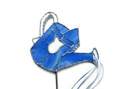 Stained Glass Garden Stake Blue Watering Can by Nostalgianmore, $75.00 Looks so cool when placed so it appears to be watering your flowers!