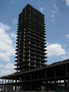 """Szkieletor building, Poland. Known as the """"Skeleton"""", this building was originally intended as a conference centre and hotel. Work started on it in 1975 but it was never completed due to lack of money. Now it lies derelict, dominating the Krakow skyline, an ugly reminder of the Communist era."""