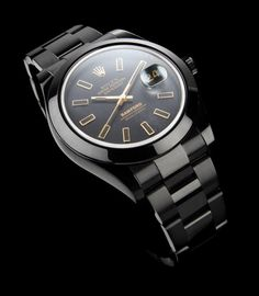 Bamford Watch Department releases one of their best looking customs yet, a blacked out yet completely refined version of the new Rolex Datejust. The gold markers of the Bi-colour dial is a perfect contrast against Bamford's popular black PVD coating.