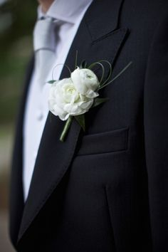 Evan's ranunculous boutonniere, (but only a single one, size wise)