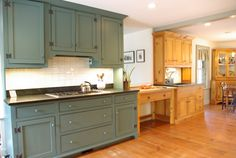 Browsing Victorian-era kitchens for good ideas, and I love the combination of deep teal and wood grain here.