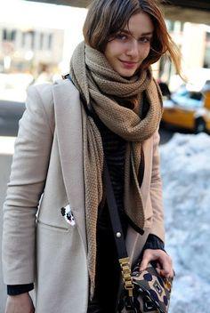 Taupe coat, black on black underneath, tan scarf