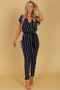 Vertical Striped Short Sleeve Jumpsuit Navy, An adorable classic jumpsuit with short sleeves, a vcut neckline, a keyhole detail along the back with a button closure, an elastic waistband and a matching fabric belt. Jumper Outfit Jumpsuits, Casual Jumpsuit, Jumpsuit Outfit, Event Dresses, Casual Dresses, Fashion Dresses, Casual Cocktail Attire, Pantalon Large, Jumpsuit With Sleeves