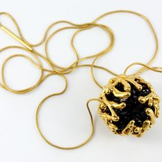 Vicky Forrester, PRECIOUS lll (joy). 22 carat Gold plate on Sterling silver, with black diamonds