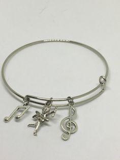 Musical charm bangle bracelet by Pinkarrowheadranch on Etsy https://www.etsy.com/listing/525132171/musical-charm-bangle-bracelet