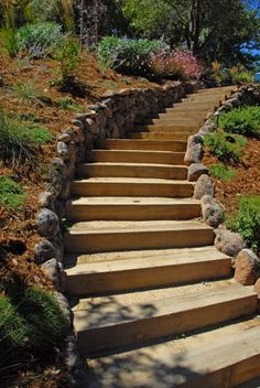 moss rock retaining wall stairs - not crazy about . Landscaping On A Hill, Landscaping With Rocks, Landscaping Ideas, Outdoor Landscaping, Railroad Ties Landscaping, Natural Landscaping, Farmhouse Landscaping, Driveway Landscaping, Landscaping Plants