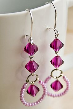 Earrings... I don't like the little beads... but I like the two beads, an o-ring and then another bead idea!