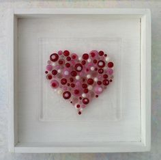 """Fused glass heart picture. (Looks like small glass """"beads"""" tack fused on a clear glass background."""