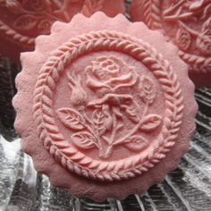 Raspberry flavored little rose cookie with tinted white chocolate on the back. Heavenly! Made with Springerle Joy mold 2329. www.springerlejoy.com