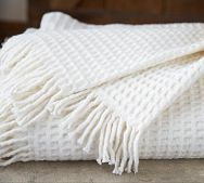 I can't get enough cozy blankets for snuggling on the couch! And I love waffle patterns.