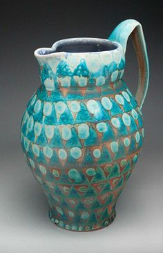 loveliness by Mark Knott. So much to like about this pitcher; the blue/brown combo; wax resist; funky imperfect handle; glaze layering