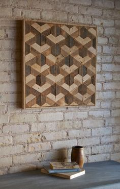 This is a one of a kind wall piece that is 24 wide by 23.5 high and 1.5 deep. The frame is made from the same material. It can be hung from any side you choose. This could also be used as a side table or nightstand if you add legs. It is made from reclaimed lath wood that was