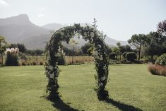 Beautiful and simple Floral Arch for Luxury Russian Wedding in Mallorca.    Set up & Deco by Mille Papillons.    See more in www.millepapillons.com