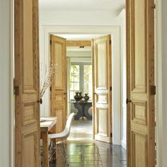 Solid hardwood doors finished in a natural wax or oil is the only finish. Especially with a well joined and painted architrave surround.