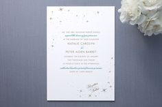 A wedding invitation with starts for a winter wedding