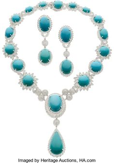 Turquoise, Diamond, White Gold Jewelry Suite Necklace featuring oval-shaped turquoise cabochons ranging in size from 10.50 x 8.90 mm to 24.00 x 17.50 mm, round turquoise cabochons ranging in size from 12.50 mm to 15.50 mm, and one pear-shaped turquoise cabochon measuring 32.00 x 17.00 mm, enhanced by full-cut diamonds weighing a total of approximately 17.00 carats;  pair of earrings; all in rhodium finished 14k gold. Total diamond weight is approximately 20.00 carats. Gross weight 186.50…